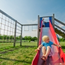 Lapsed saavad lustida samal ajal siseõuel oleval mänguväljakul